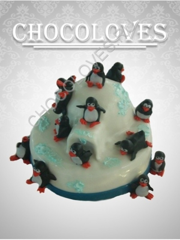 Детский торт с веселыми пингвинами
